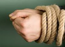 Picture of hands tied and how addiction ties you, even women get addicted.