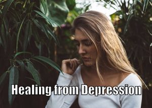 """Depressed girl looking down with the text saying, """"Healing from Depression."""""""