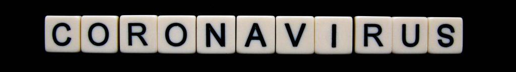 COVID 19 representation using Yahtzee dice to spell out coronavirus.